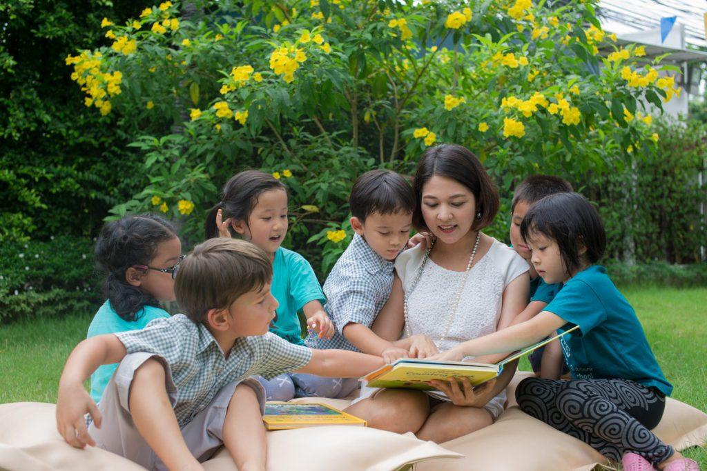 Founder Kiki reading to kids at OSB